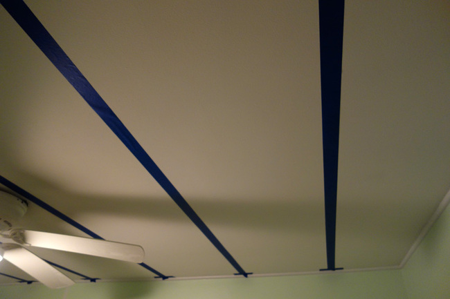 I used 1.8 inch painters tape to mark off where the beams in the ceiling were so I didn't drill the holes for the stars in to a beam.