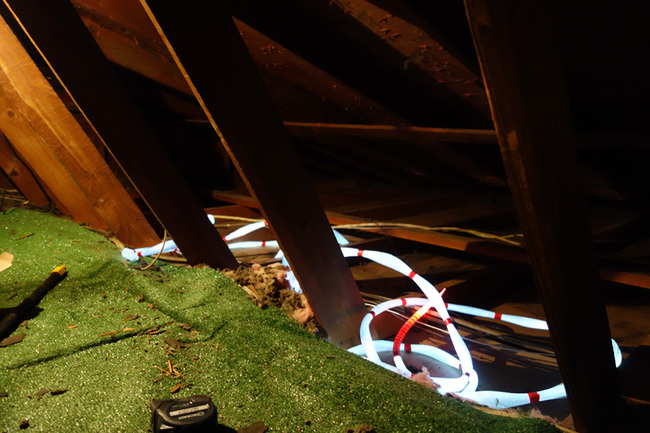 Bundles in the attic. I recommend stretching them in the opposite direction you are installing and laying them flat. One of the most tedious things about the project is trying to pull individual strands from the bundle to install while keeping the rest of the strands from tangling.